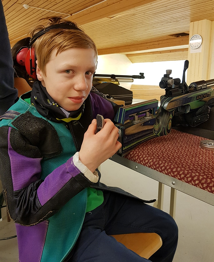 Otto sitting on a chair in the shooting hall looking into the camera