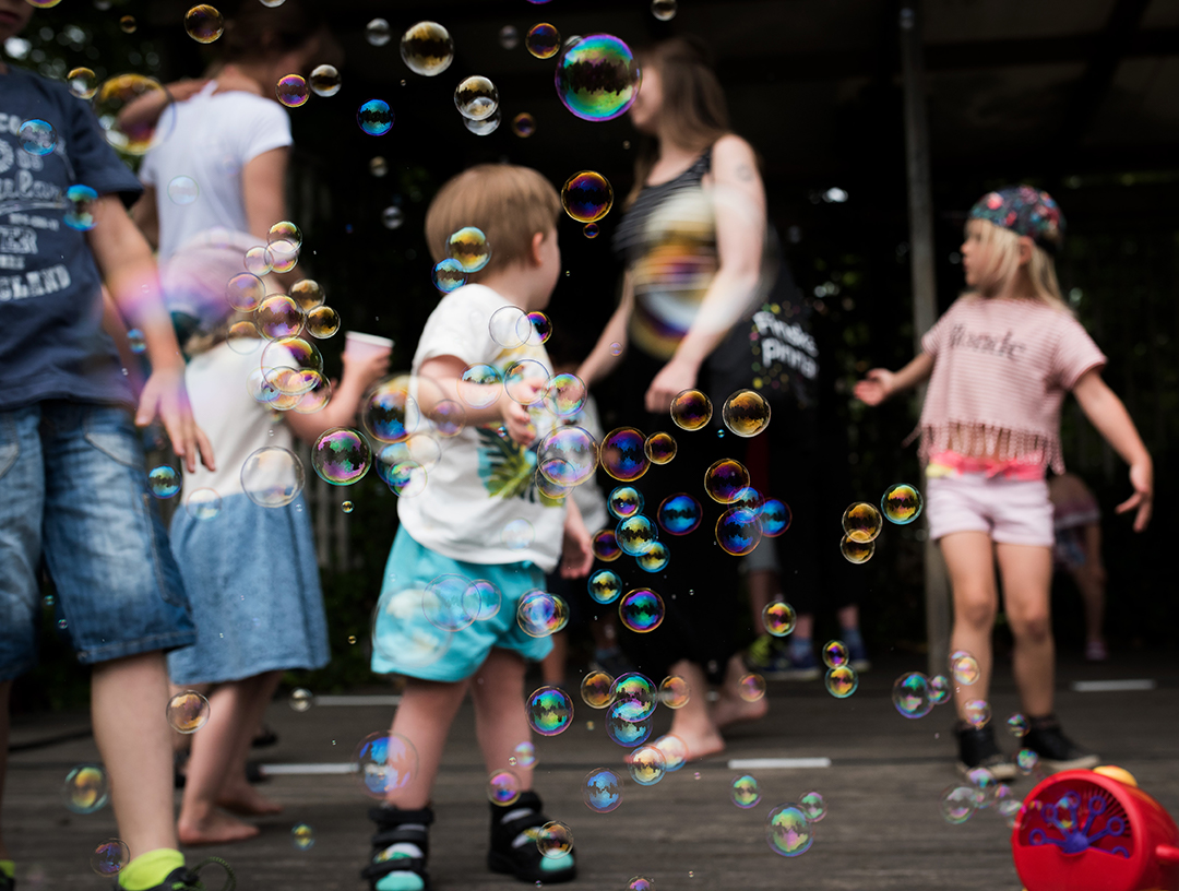 kids playing in bubbles